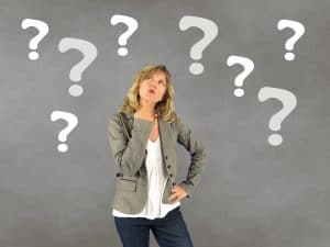 A woman looks puzzled with question marks around her head