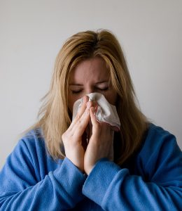 A woman wiping her nose