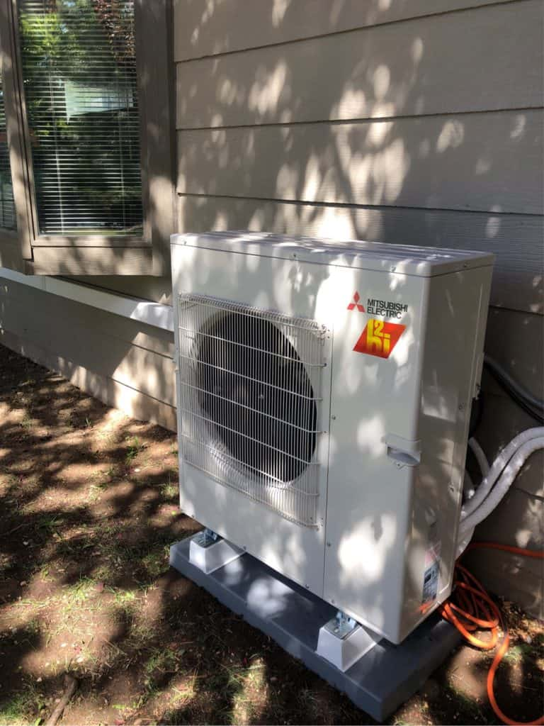 Mitsubishi hyper heat model heat pump outside a Meridian, ID home